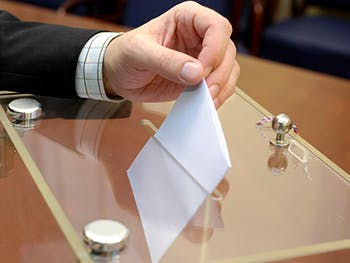 Centre for Brexit Studies Voter Perceptions Image 350x263- Hand placing a voting slip in a box