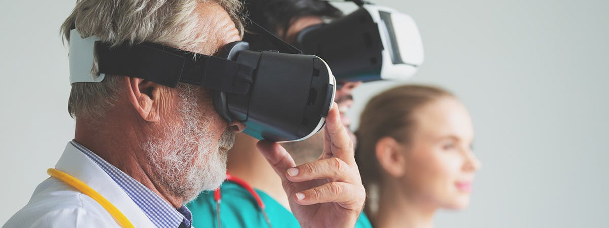Doctors wearing VR headsets