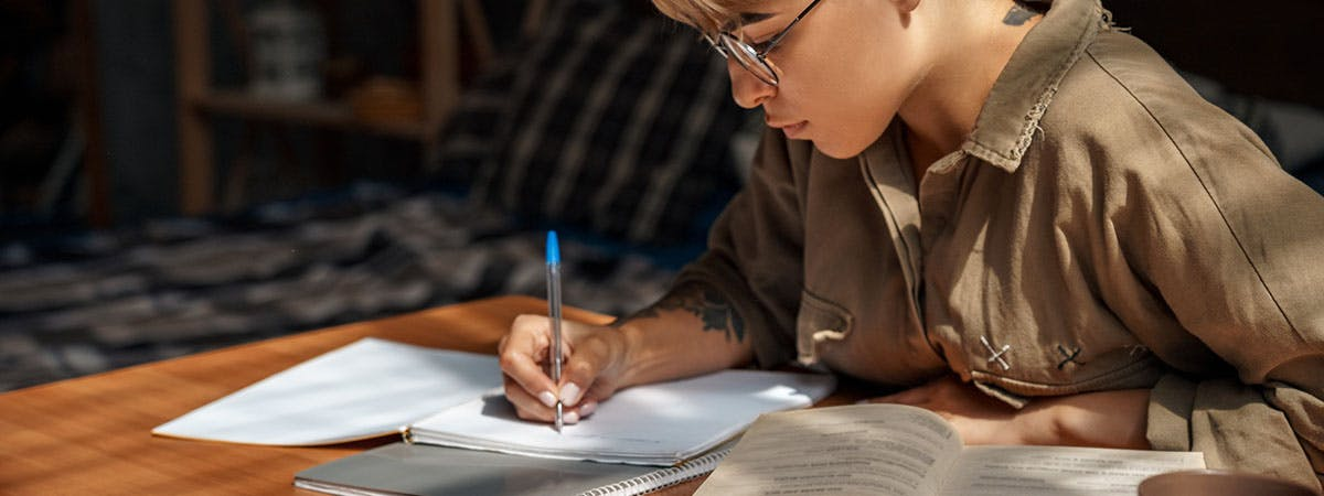 A woman taking part in a writing session