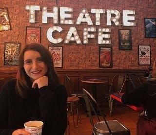Media graduate in a theatre cafe